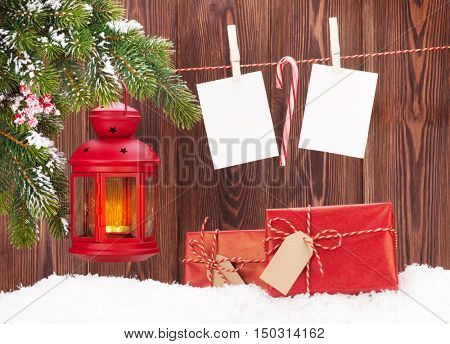Christmas candle lantern, gift boxes and blank photo frames