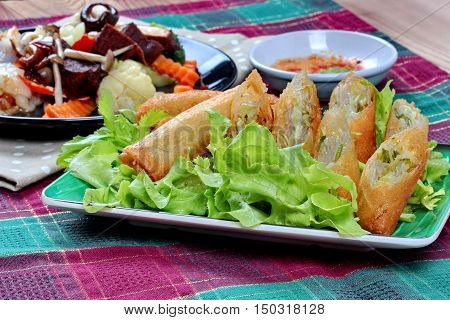 Close up of deep fried spring roll  as four sheet wrap  fried vermicelli and sliced cabbage in roll bar to deep fried call