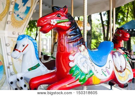 Red old carousel Horse in the park