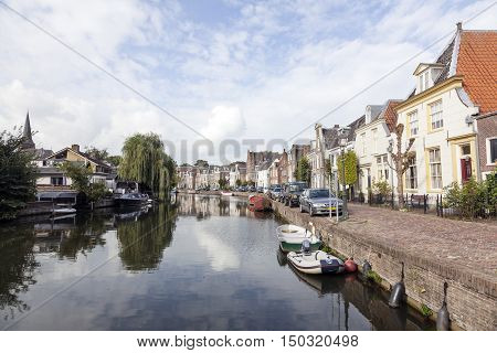 Maarssen, Netherlands, 30 september 2016: boats cars and houses along river Vecht in the dutch village of Maarssen in the netherlands