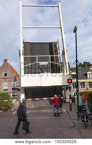 Maarssen, Netherlands, 30 september 2016: old wooden drawbridge and waiting people in centre of Maarssen