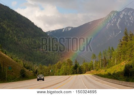Car driving on Trans-Canada highway through Rockies in Alberta, Canada