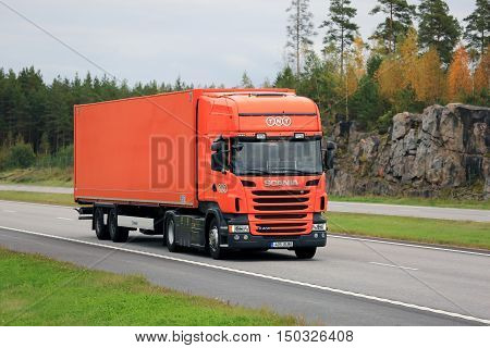 PAIMIO, FINLAND - SEPTEMBER 23, 2016: Orange Scania R400 semi cargo truck of TNT moves along motorway on a cloudy day of autumn in South of Finland. TNT Express is an international courier delivery services company with headquarters in Hoofddorp Netherlan
