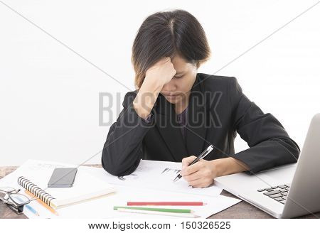 Business woman sitting on desk office with tired or strain and headache