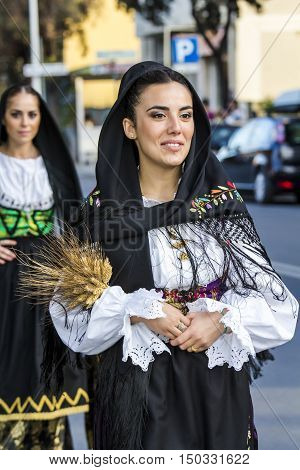 QUARTU S.E., ITALY - September 17, 2016: Parade of Sardinian costumes and floats for the grape festival in honor of the celebration of St. Helena. - Sardinia - portrait of a beautiful girl in traditional Sardinian costume