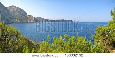 Bay Panorama With Blue Ocean, Green Nature And Mountains
