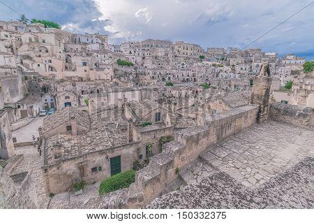Panoramic View Of Stones (sassi Di Matera)  Of Matera Under Blue Sky. Matera In Italy