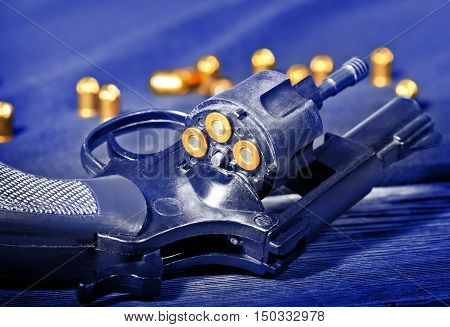 detail of a revolver with blank cartridge