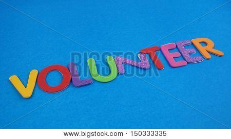 Volunteer word on blue background