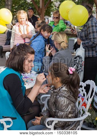 Moscow - September 10 2016: the City Day in Moscow and people came to the celebration on Tverskaya street children and do artistic painting the face September 10 2016 Moscow Russia