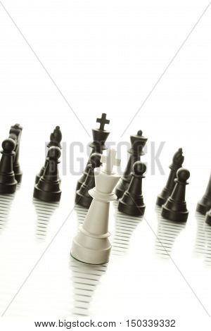 Chess pieces embody business strategy. Isolated on white background