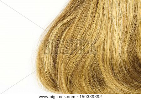 Blonde thick hair isolated on white background