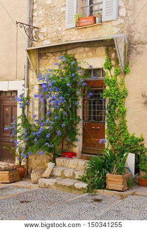 beautiful old town street with old door in Provence , France