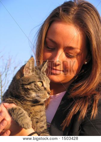 Brunette Girl Holding Her Cat