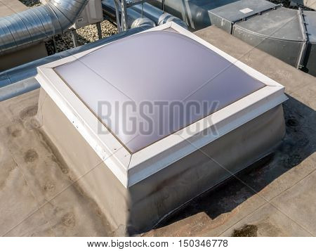 Roof manhole with plastic cover