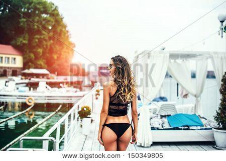 Brunette Girl In Black Swimsuit Relaxing Outdoor