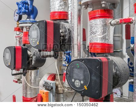 Group of hot water circulating pumps installed in boiler room