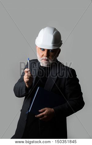 Man In Hard Hat With Notebook