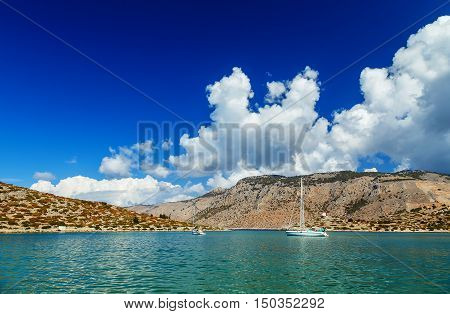 Boats in the harbor of Panormitis. Symi island, Greece