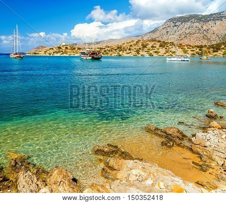 View of beautiful bay in Bay of panormitis of Symi island , the ships. and boats at anchor, Greece