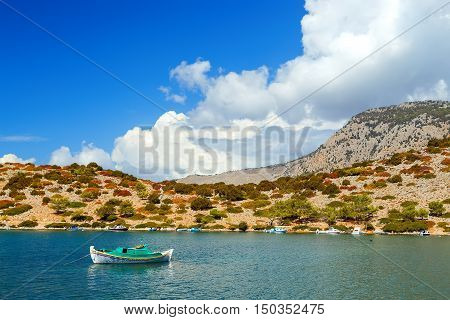 Sinking sailboat in shallow water after a storm on Simi island. Greece. Europe