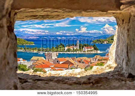 Vis island bay waterfront view through stone window Dalmatia Croatia