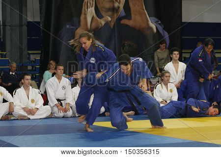 BELGRADE,SERBIA - SEPTEMBER 24, 2016: Girl and young man demonstrate actions at martial arts evening
