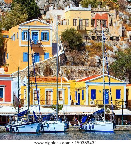 Pier Simi island with beautiful houses, similar to puppet,