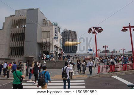 TOKYO  , JAPAN - MAY 2 , 2016 :   tokyo cruise Station andThe Asahi Beer  at asakusa Tokyo Japan, Tokyo, Japan. MAY 2 2016.