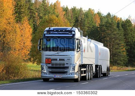 SALO, FINLAND - OCTOBER 2, 2016: New Volvo FH fuel tank truck on rural road in autumn. The ADR code 33-1203 signifies gasoline.