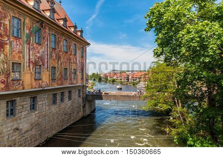 Bamberg Germany - May 22 2016: Wall of the Old Town Hall (1461) with frescoes (1756) and Lower Bridge. Historic city center of Bamberg is a listed UNESCO world heritage site.