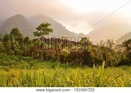 Foggy sunset landscape surrounding the small village of coffee growers in the highlands of Honduras. Santa Barbara National Park