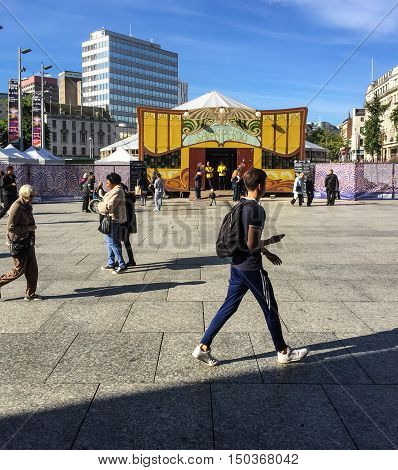 NOTTINGHAM ENGLAND - OCTOBER 3: Various people walking through Nottingham Market Square. In Nottingham England. On 3rd October 2016.