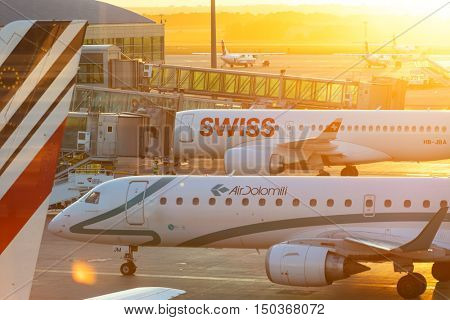 PRAGUE - August 13, 2016: Commercial airplanes at Vaclav Havel Airport Prague on August 13, 2016, boarding passengers in beautiful sunset.