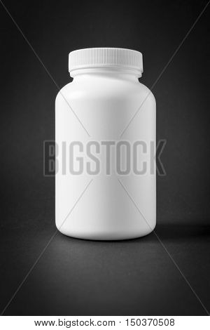 An image of a white plastic jar isolated on black