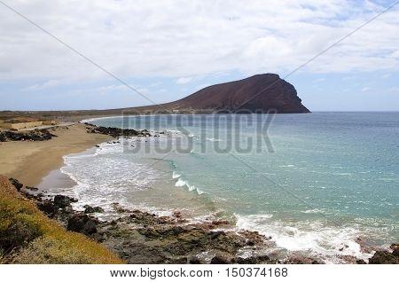 Beach Playa de la Tejita with Montaña Roja red montain. Tenerife Canary Island Spain