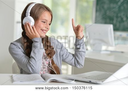 portrait of cute  girl using laptop computer