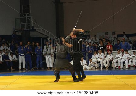 BELGRADE,SERBIA - SEPTEMBER, 24 2016: Fighters demonstrate actions at martial arts evening