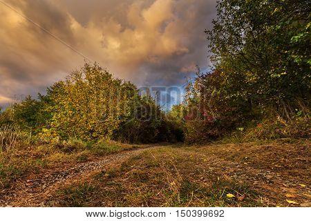 Sunburst clouds and colorful autumn. Moravian landscape Svitavka.