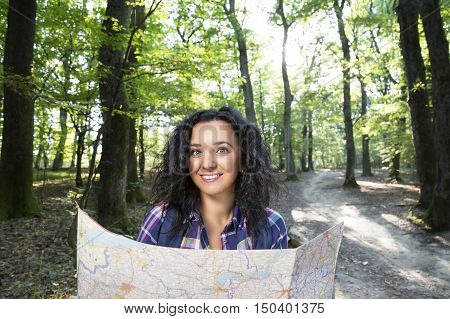 Young woman walks hike in the woods.
