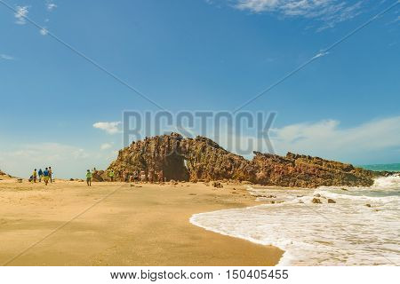 JERICOACOARA, BRAZIL, DECEMBER - 2015 - Front view of pedra furada a famous geological rock located in the beach at Jericoacoara Brazil