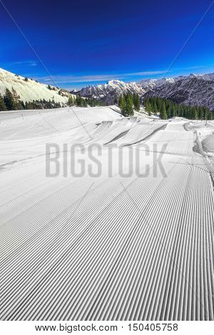 Ski slopes with the corduroy pattern on the top of Fellhorn Ski resort Bavarian Alps Oberstdorf Germany