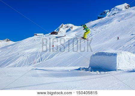 HOCH YBRIG SWITZERLAND - February 26 2015 - Flying skier skiing in Hoch-Ybrig mountain resort Switzerland