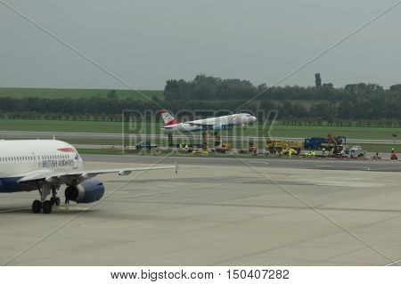 British Airways Aircraft On The Runway And Austrian Airlines Air