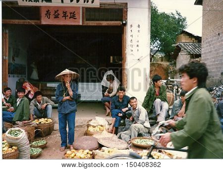 GUILIN / CHINA - CIRCA 1987: Sidewalk vendors sell fresh vegetables in Guilin.