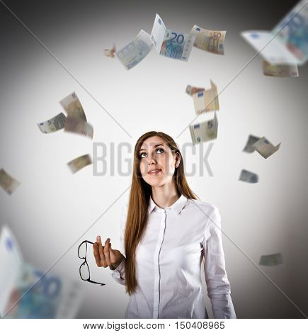 Woman in white and falling Euro banknotes. Currency and lottery concept.