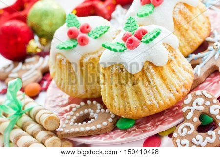 Traditional cuisine. Christmas treats cupcakes cookies on a festive table close up selective focus