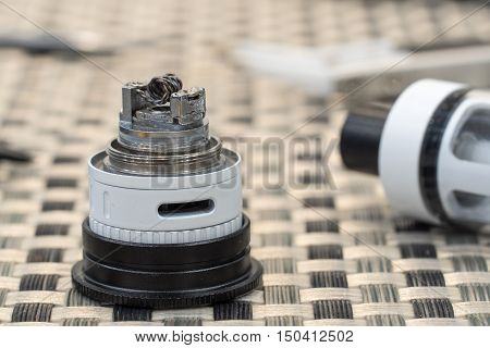 Coil atomizer replacement parts for tank or subtank vaporizer or e-cigarette. Useful for vaping enthusiasts. poster