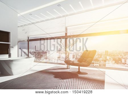 Warm glow of the rising sun in a modern bathroom interior shining through a panoramic view window onto a modern freestanding tub and chair in a 3d rendering