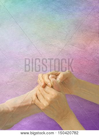 Working the Pituitary Gland Reflex Point - Female reflexologist working on man's big toe applying pressure to the Pituitary Gland Reflex point on a pastel colored parchment effect background with copy space above